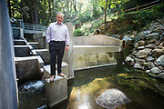California Water Service Group's CEO Martin Kropelnicki poses for a portrati at the recently built Fish Ladder along Bear Gulch Creek in Woodside, California, on July 25, 2018. (Stan Olszewski for Silicon Valley Business Journal)
