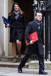 London, UK. 18th December, 2018. Alun Cairns MP, Secretary of State for Wales, and Caroline Nokes MP, Secretary of State for Immigration, leave 10 Downing Street following the final Cabinet meeting before the Christmas recess. Topics discussed were expected to have included preparations for a 'No Deal' Brexit.