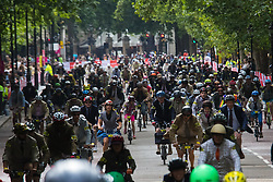Westminster, London August 1st 2015. Dozens of cyclists race their Brompton folding commuter bicycles along Birdcage walk in a race around St James's Park.