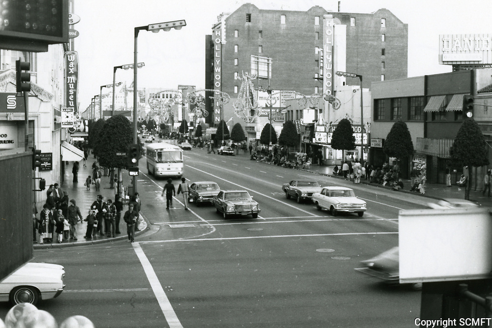 1975 Looking east at Hollywood Blvd. & Highland Ave. during Christmastime