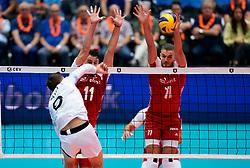 13-09-2019 NED: EC Volleyball 2019 Estonia - Poland, Rotterdam<br /> First round group D - poland win 3-1 / Robert Täht #9 of Estonia, Fabian Drzyzga #11 of Poland, Paweł Zatorski #17 of Poland