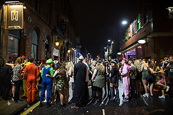 © Licensed to London News Pictures . 26/12/2015 . Wigan , UK . Revellers in Wigan enjoy Boxing Day drinks and clubbing in Wigan Wallgate . In recent years a tradition has been established in which put on fancy dress for a Boxing Day night out . Photo credit : Joel Goodman/LNP