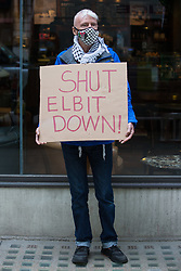 An activist from Palestine Action protests outside the UK headquarters of Elbit Systems, an Israel-based company developing technologies used for military applications including drones, precision guidance, surveillance and intruder-detection systems, on 28th May 2021 in London, United Kingdom. Pro-Palestinian activists had organised the protest against Elbit's presence in the UK and against British arms sales to and support for Israel.