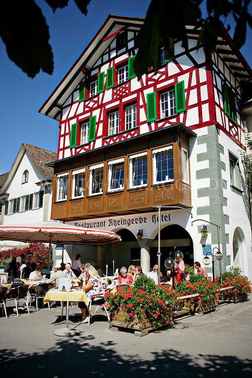 Diners enjoying a beautiful day outside of the Rheingeebe Restaurant and Hotel, Stein am Rhein, Switzerland