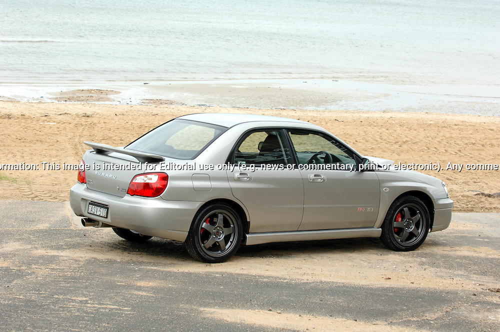 """Subaru Impreza WRX WRP10 - a limited edition model exclusive to the Australian market - at Mentone Beach.The WRP10 was available from late January 2005 and was limited to 200 units, featuring individually numbered badges..The model name comes from Subaru's heritage, the """"WR"""" represents Impreza WRX's success in World Rally competition, """"P"""" the enormous rallying contribution from Pirelli tyres and """"10"""" the years since launch of the original Impreza WRX""""..Available exclusively in Crystal Grey Metallic manual sedan, the WRP10 includes a STI engine performance upgrade kit increasing peak power from standard WRX's 168 kW @ 6,000 rpm to175kW @ 6,000 rpm..The kit includes a replacement Electronic Control Unit, upgraded exhaust components and a unique large single tip muffler..A carbon fibre strut brace and WRX suspension lowering kit, with stiffer springs drop the car's ride height by 15mm..WRP10 is finished off with high performance, lightweight five-spoke forged alloy RAYS wheels and Pirelli P Zero Nero tyres (215 45Z R 17 91Y)..The limited edition model was the first developed by STI Australia, in conjunction with STI Japan .(C) Joel Strickland Photographics.Use information: This image is intended for Editorial use only (e.g. news or commentary, print or electronic). Any commercial or promotional use requires additional clearance."""