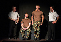 """Scott Alward (Lieutenant Sam Weinberg),  Trevor Lewis (Private First Class Louden Downey),  Braeden Alward (Lance Corporal Harold Dawson)  and Chris Fernandez (Lieutenant Daniel Kaffee) in a briefing scene during dress rehearsal for """"A Few Good Men"""" with Laconia Streetcar Company Thursday evening at Laconia High School.  (Karen Bobotas/for the Laconia Daily Sun)"""