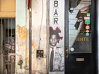 A Jean-Michel Basquiat stencil on a building wall at the entrance to El del Frente in Old Havana.