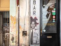 A Jean-Michel Basquiat stencil on a building wall at the entrance to El del Frente in Old Havana.