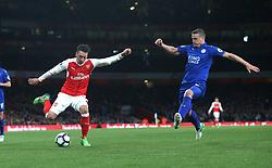26 April 2016 London : Premier League Football : Arsenal v Leicester City :<br /> Mesut Ozil of Arsenal and Robert Huth of City.<br /> Photo: Mark Leech