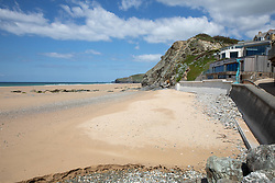 """© Licensed to London News Pictures. 11/05/2020. Newquay, UK. Watergate Bay beach on the North coast of Cornwall is empty, the day after British Prime Minister Boris Johnson announced a 'road map' to lift lockdown restrictions due to Covid-19, (Coronavirus). A rise in """"staycations"""" - the concept of holidaying in your home country rather than travelling abroad - is expected, with many visitors planning to visit Cornwall. However, an ongoing campaign titled """"#ComeBackLater"""" is trying to persuade tourists not to visit the county until it is safe to do so. Photo credit : Tom Nicholson/LNP"""