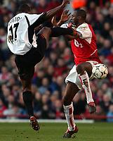 Photo. Javier Garcia<br />01/02/2003 Arsenal v Fulham, FA Barclaycard Premiership, Highbury<br />Patrick Vieira avoids a high challenge from Martin Djetou