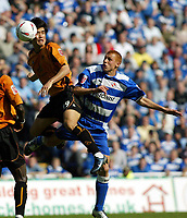 Photo. Chris Ratcliffe<br /> Reading v Wolverhampton Wanderers. Coca Cola Championship. 30/04/2005<br /> Ki-Hyeon Seol of Wolves goes up for an aerial ball with Steve Sidwell of Reading