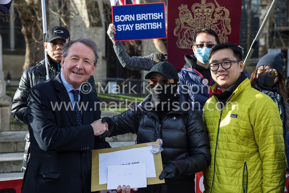London, UK. 29 January, 2020. David Alton, Baron Alton of Liverpool, prepares to receive a petition from Hong Kong residents protesting opposite Parliament to call for the reopening and broadening of the British National Overseas (BNO) passport scheme to Hong Kong citizens. Around 169,000 Hong Kong residents hold active BNO passports under the scheme from the period 1987-1997. Tomorrow they will visit the Foreign and Commonwealth and Home Offices to deliver a petition.
