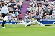 Sam Curran of England dives over his crease to avoid being run out while batting during the first day of the 4th SpecSavers International Test Match 2018 match between England and India at the Ageas Bowl, Southampton, United Kingdom on 30 August 2018.