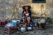 Street vendor eating her noodles, Hue
