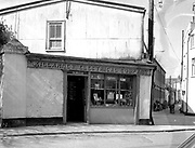Mrs. McDonnell's photo shop in College Street, Killarney inn front of The Glebe Hotel. The shop subsequently became The dawn Photo Shop and lately the Vodafone shop.<br /> Killarney Now & Then - MacMONAGLE photo archives.<br /> Picture by Don MacMonagle -macmonagle.com