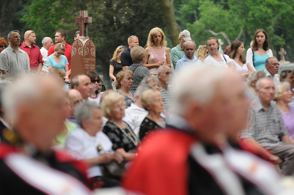 Catholics are gathered for a Memorial Day Field Mass celebrated by Bishop Thomas J. Paprocki at St. Adalbert Cemetery in Niles.