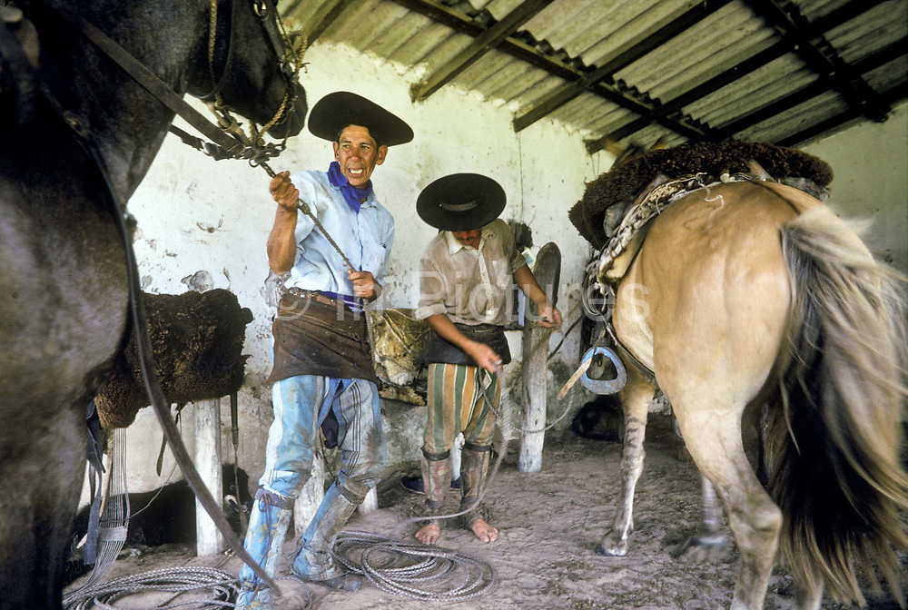 Gauchos saddling up to begin the days work on ranch