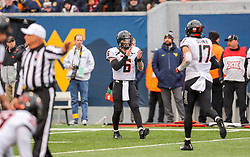 Nov 23, 2019; Morgantown, WV, USA; Oklahoma State Cowboys quarterback Dru Brown (6) celebrates with West Virginia Mountaineers wide receiver Freddie Brown (17) after throwing a touchdown pass during the fourth quarter against the West Virginia Mountaineers at Mountaineer Field at Milan Puskar Stadium. Mandatory Credit: Ben Queen-USA TODAY Sports