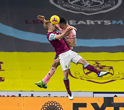 BURNLEY, ENGLAND - Tuesday, December 29, 2020: Burnley's captain Ben Mee (L) and Sheffield United's John Egan during the FA Premier League match between Burnley FC and Sheffield United FC at Turf Moor. Burnley won 1-0. (Pic by David Rawcliffe/Propaganda)