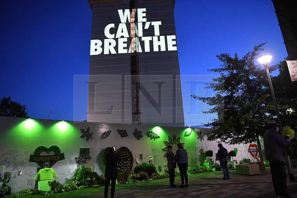 """© Licensed to London News Pictures. 05/07/2020. London, UK. A light projection reading'WE CAN'T BREATHE'is cast onto the shell of Grenfell Tower in West Londonon the eve of the second phase of the Grenfell Tower Fire Inquiry. The slogan echoes the words spoken on the night recorded oncalls to emergency services and loved onesbegging for help that never came. Abbas Dadou, Chairman of Lancaster West Estate Residents Association comprising 800 homes and 2000 residents said """"We stand in solidarity with the families who lost their loved ones in their fight for justice. They are us and we are with them. They are part of our community and their fight for justice is our fight."""" El Alami Hamdan who lost his daughter and his grandchildren in the fire said """"how long must we wait for justice? It has been three years and still nothing. They promise everything and they do nothing""""'<br /> <br /> A press conference will be held this morning ahead of the Inquiry resuming, where a full statement will be released at 10am """"Family members of those who perished in the fire that took the lives of 72 people on June 14 in 2017 attended the projection of 'We can't breathe' These words echo what we heard on the 999 calls of our loved ones, or the last breath taken by our brothers and sisters, mothers and fathers and our children that night as they begged for help. We have had to listen to these calls as part of the Inquiry reliving their pain and suffering and the failures which cost the lives of our lovedones that night. We are no longer going to keep silent. We demand justice. We want prosecutions. Our loved ones are not here to speak for themselves and we must speak for them"""". Photo credit: Guilhem Baker/LNP"""