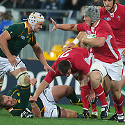 Jonathan Davies, Wales, (right) fends off Heinrich Brussow, South Africa, during the Wales V South Africa, Pool D match during the Rugby World Cup in Wellington, New Zealand,. 11th September 2011. Photo Tim Clayton