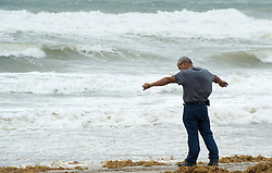 A man tests the strength of the wind along the beach in anticipation for Hurricane Irma Saturday, September 9, 2017 in Hollywood, FL, USA. Photo by Paul Chiasson/CP/ABACAPRESS.COM