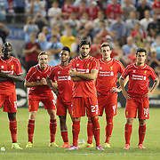 Liverpool players watch Lucas Leiva take the winning penalty during the Manchester City Vs Liverpool FC Guinness International Champions Cup match at Yankee Stadium, The Bronx, New York, USA. 30th July 2014. Photo Tim Clayton