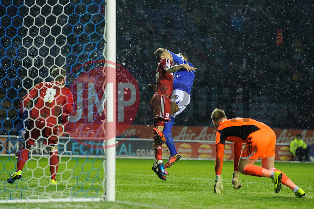 Middlesbrough Defender Sebastian Hines (ENG) blocks a header from Leicester Defender Wes Morgan (ENG) (capt) as Middlesbrough Goalkeeper Jason Steele (ENG) scrbbles back to his net during the first half of the match - Photo mandatory by-line: Rogan Thomson/JMP - Tel: Mobile: 07966 386802 18/01/2013 - SPORT - FOOTBALL - King Power Stadium - Leicester. Leicester City v Middlesbrough - npower Championship.