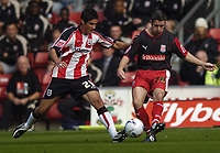 Photo: Jonathan Butler.<br />Southampton v Stoke City. Coca Cola Championship. 21/10/2006.<br />Andy Griffin of Stoke City is tackled by Andrew Surman of Southampton.