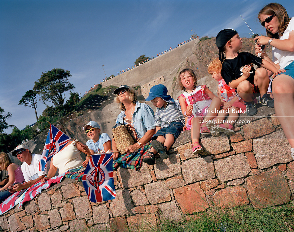 Young fans of the 'Red Arrows', Britain's Royal Air Force aerobatic team beofre the display at Jersey air show.