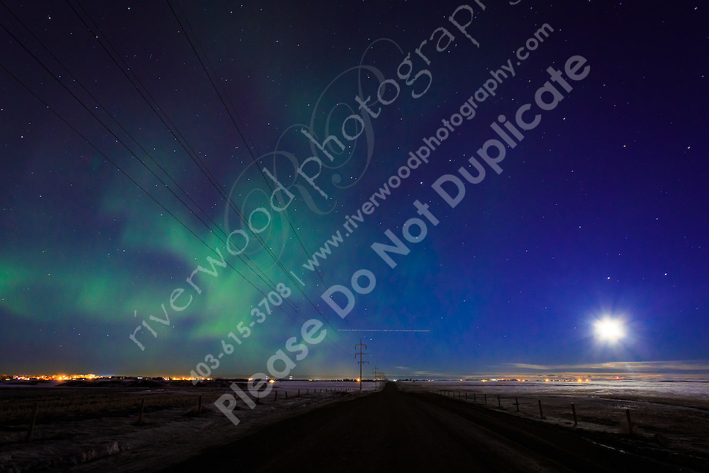 Another solar storm washed over the Northern Hemishere tonight and the Northern Lights were clearly visible to the naked eye all around the City of Calgary. It was an amazing sight to see!<br /> <br /> ©2014, Sean Phillips<br /> http://www.RiverwoodPhotography.com