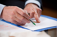 20 JAN 2010, BERLIN/GERMANY:<br /> Peter Ramsauer, CSU, Bundesverkehrsminister, malt eine Skizze auf ein Blatt papier, waehrend einem Interview, in seinem Buero, Bundesministerium fuer Verkehr, Bau und Stadtentwicklung<br /> IMAGE: 20100120-01-018<br /> KEYWORDS: Büro