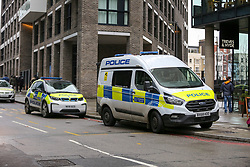 © Licensed to London News Pictures. 23/11/2019. London, UK. Police vehicles are seen nearby Buckle Street in Tower Hamlets, East London following a fatal stabbing.<br /> Police were called to a residential address in Blakeney Tower on Buckle Street, Tower Hamlets in East London at 08.48hrs this morning following reports of a stabbing. A male, in his 20s, was found with stab injuries. Despite the efforts of emergency services, he was pronounced dead at the scene. Three other males with stab injuries were treated at the scene by paramedics before being taken to hospital. Photo credit: Dinendra Haria/LNP