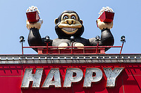 Happy Gorilla Pachinko Parlour - Pachinko is a mechanical game   - a kind of arcade game and  a discrete form of gambling.  Looking like vertical pinball machine, with no flippers and uses a large number of tiny balls and almost no skill whatsoever to play, rather it is a game of patience.