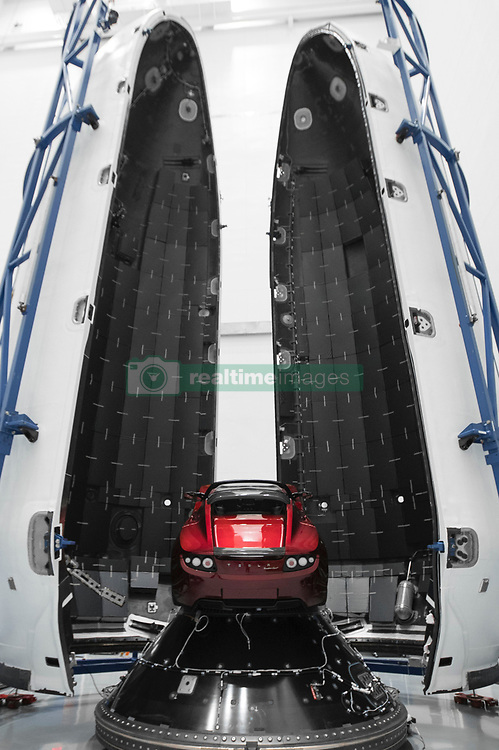 December 22, 2017 - Hawthorne, California, U.S. - Earlier this month Tesla CEO Elon Musk announced that SpaceX's Falcon Heavy will have a payload on its maiden launch that will be none other than his very own Cherry Red Tesla Roadster. Friday, Musk revealed the setup in a photo slideshow posted to Social media. The Roadster appears bright red in the center of SpaceX's slate grey rocket, called Falcon Heavy and will undergoe a billion year elliptic Mars orbit. Image Taken Dec. 5th, 2017. (Credit Image: ? Space X/ZUMA Wire/ZUMAPRESS.com)