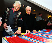 2 men judging at the 82nd Annual Rhubarb Show, Cedar Court Hotel, Caldergrove, Wakefield. February is high season for the forced rhubarb of the so-called 'Rhubarb Triangle' formed by Wakefield, Rothwell and Morley. These intensely flavoured plants with pink stems and yellow leaves - grown by candlelight and tended by hand in huge, heated forcing sheds - are one of the first culinary delights of the British winter.