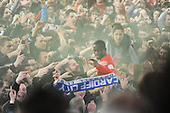 Cardiff city player Leon Barnett (in centre) is mobbed by fans as Cardiff celebrate promotion to the Premier league. NPower championship, Cardiff city v Charlton Athletic at the Cardiff city stadium in Cardiff, South Wales on Tuesday 16th April 2013. pic by Andrew Orchard,  Andrew Orchard sports photography,