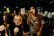"""Misao Redwolf, leader of the anti nuclear group, """"No nukes, more hearts"""" talks to protestors calling for the halting of all nuclear power generation in Japan outside the national diet building, Nagatacho,Tokyo, Japan. Friday September 14th 2012"""