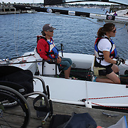 Skipper Sarah Everhart Skeels, (left), Tiverton, RI, and Cindy Walker, Middletown, RI, the only all female team competing in The Skud 18 class, preparing for competition during the C. Thomas Clagett, Jr. Memorial Clinic & Regatta at Newport, Rhode Island hosted by Sail Newport at Fort Adams. <br /> The Clagett is North America's premier event for sailors with disabilities with sailors competing in the 3 Paralympic class boats and is an integral part of preparation for athletes preparing for  Paralympic and world championship racing. Newport, Rhode Island, USA. 26th June 2015. Photo Tim Clayton