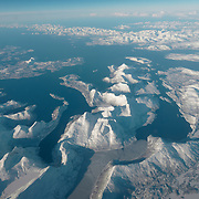 Flying over the Norwegian archipelago of Svalbard on our way into Longyearbyen, Norway.
