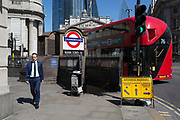 A businessman walks past one entrance of Bank Underground Station in the City of London, the capital's ancient, financial district, on 14th May, in London, England.