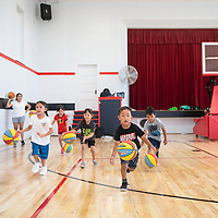 Campers dribble the ball to half court during a ball handling drill Thursday morning at St. Michael Indian School summer basketball Cardinal Camp in St. Michaels, Arizona.
