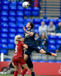 Liverpool Women's Laura Coombs (left) and Manchester United Women's Jessica Sigsworth contest a header during the Continental Tyres Cup, Group Two North match at Prenton Park, Birkenhead.