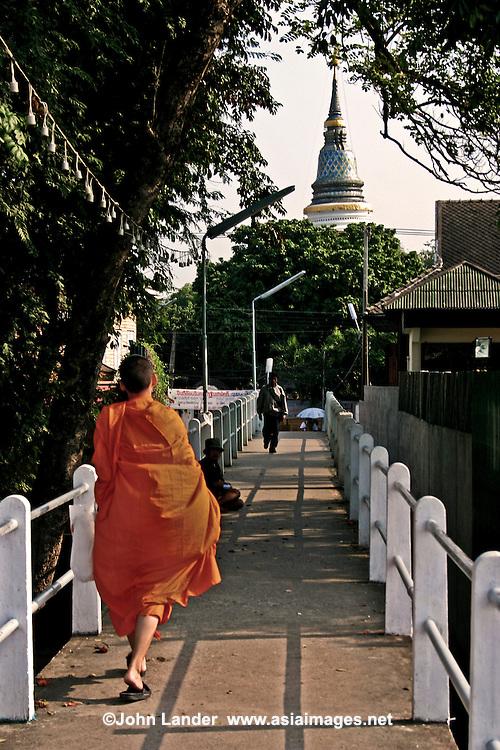 Novice Monk on Footbridge