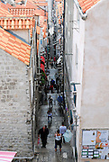Elevated view, looking down narrow side street from city walls. Dubrovnik old town, Croatia