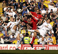 Photo. Jed Wee<br />Liverpool v Leeds United, FA Barclaycard Premiership, Anfield, Liverpool. 23/03/2003.<br />Liverpool's Sami Hyypia (C) gets to the ball first despite the double team from Leeds' Alan Smith (L) and Nick Barmby.