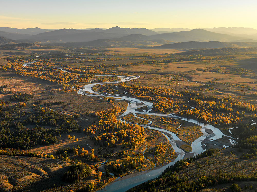 Aerial view of the Snake River near Jackson Wyoming in its autumn glow during morning first light.  Licensing and Open Edition Prints