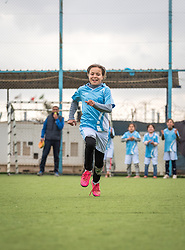 20 February 2020, Za'atari Camp, Jordan: A girl runs during a speed competition during football practice for girls in the Peace Oasis, a Lutheran World Federation space in the Za'atari Camp where Syrian refugees are offered a variety of activities on psychosocial support, including counselling, life skills trainings and other activities.