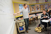 Tutor Ian Wessen of San Jose helps junior Esmeralda Perez with AP Physics homework during the EOS tutoring class during lunch at Milpitas High School in Milpitas, California, on October 13, 2014. (Stan Olszewski/SOSKIphoto)
